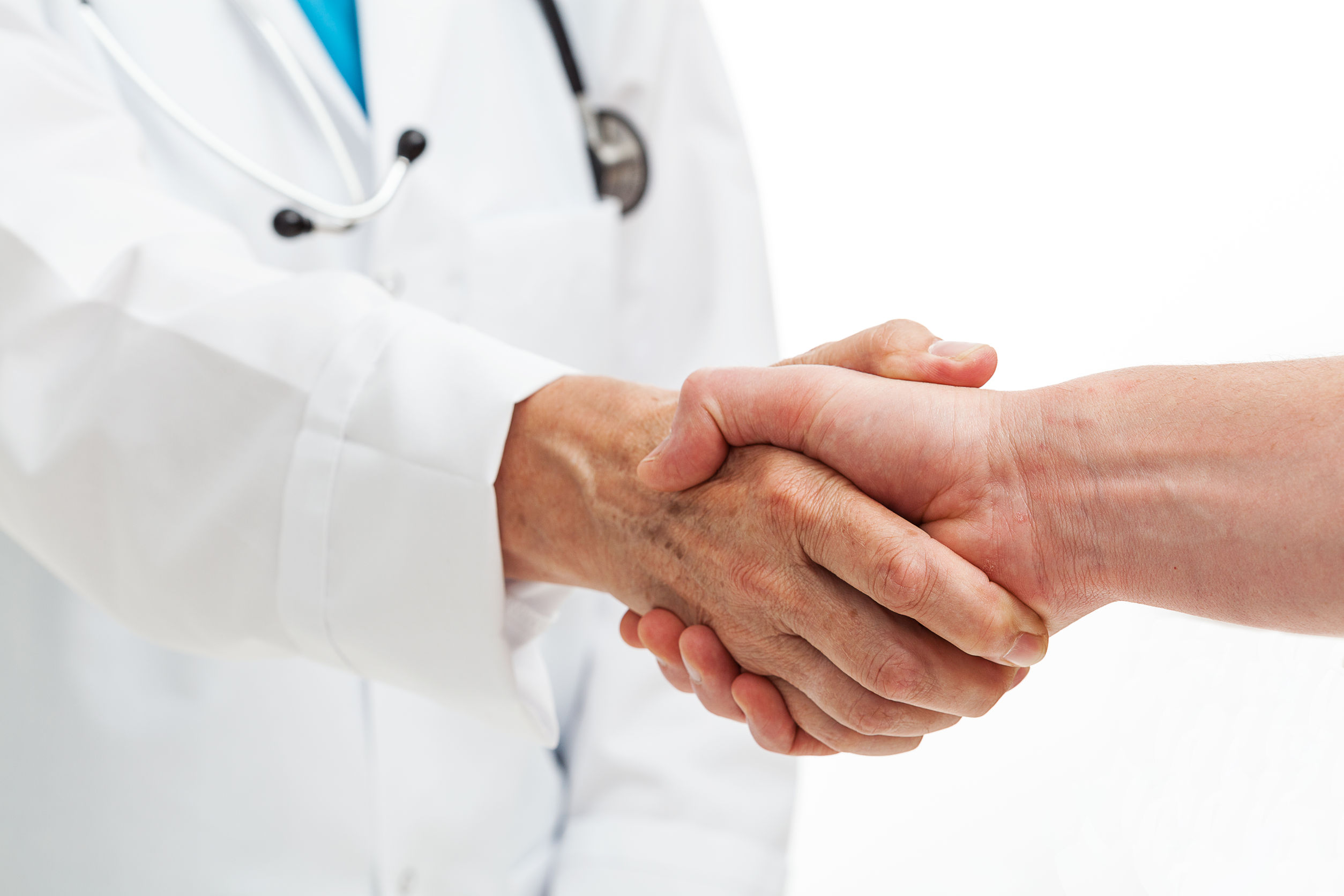 22218434 - a person shaking hands with a doctor